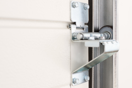 Garage door rail and wheel moving system Stock Photo