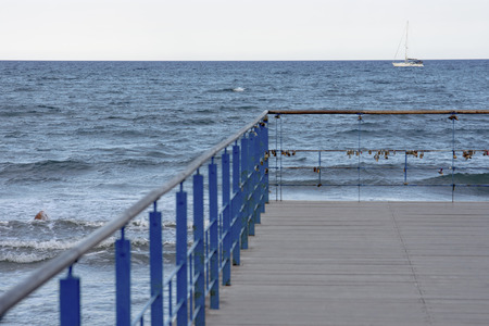 Simple pier detail with small sailing boat Banco de Imagens
