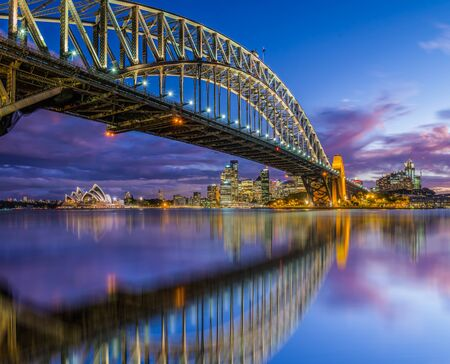 sydney harbour bridge: The Sydney Harbour Bridge reflecting in the waters of Circular Quay.