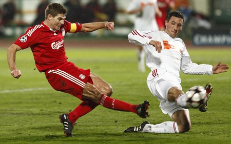Meszaros of Debrecen (R) is trying to stop the shoot of Liverpools Gerrard (L)     during Debrecen vs. Liverpool UEFA Champions League group stage match at Puskas Ferenc Stadium on 24th November 2009, in Budapest, Hungary Editöryel