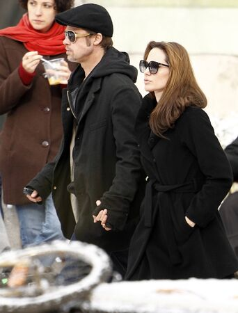 superstar: Brad Pitt (M), Angelina Jolie (R) and an unidentified person during Angelina Jolies movie shooting in 9th District, on 9th November, 2010, in  Budapest, Hungary.Brad Pitt (K), Angelina Jolie (J) és egy nem beazonosítható személy Angelina Jolie filmj� Editorial