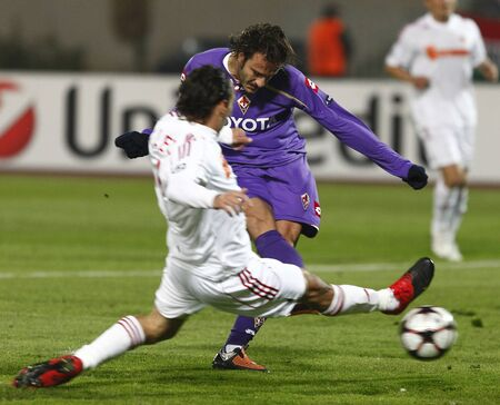 Gilardino is shooting the second goal of Fiorentina during Debrecen vs. Fiorentina UEFA Champions League group stage match at Puskas Ferenc Stadium on 20th October 2009, in Budapest, Hungary  Editorial