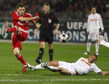 Bodnar of Debrecen (R) is watching Liverpools Fabio Auralios (L) shoot during Debrecen vs. Liverpool UEFA Champions League group stage match at Puskas Ferenc Stadium on 24th November 2009, in Budapest, Hungary