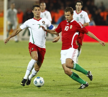 Portuguese Cristiano Ronaldo (L) and Hungarian Vadocz (R) are fighting for the ball during Hungary vs. Portugal FIFA World Cup 2010 group stage match at Puskas Ferenc Stadium on 9th September 2009, in Budapest, Hungary  報道画像