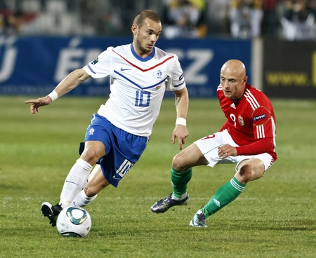 BUDAPEST - MARCH 25: Dutch Wesley Sneijder (L) and Hungarian József Varga (R) during Hungary vs. Netherlands (0:4) UEFA Euro 2012 qualifying game at Puskas Ferenc Stadium on March 25, 2011 in Budapest, Hungary. 報道画像
