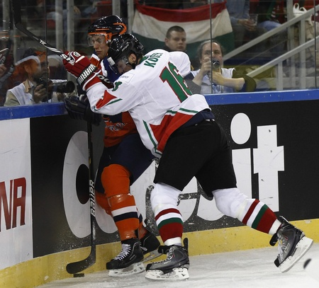 BUDAPEST - APRIL 17: Hungarian D�niel K�ger (R) is attacking an unidentified Dutch player during Hungary vs. Netherlands (7:3) IIHF Division IA World Championship at Budapest Sport Arena on April 17, 2011 in Budapest, Hungary.