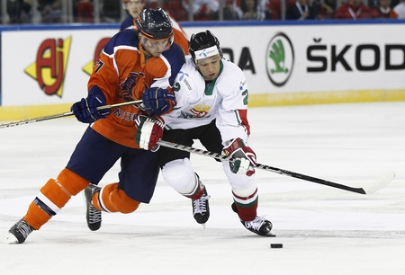 BUDAPEST - APRIL 17: Duel of Hungarian Csaba Kov�cs (R) and Dutch Diederick Hagemeijer during Hungary vs. Netherlands (7:3) IIHF Division IA World Championship at Budapest Sport Arena on April 17, 2011 in Budapest, Hungary.