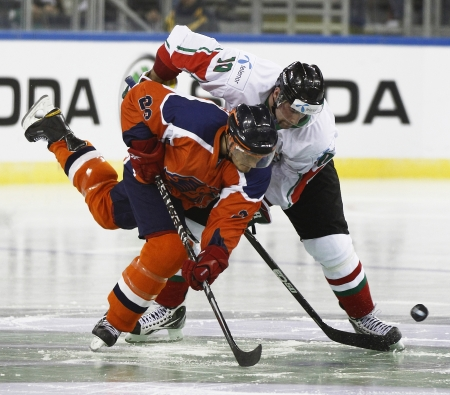 BUDAPEST - APRIL 17: Duel of Hungarian M�rton Vas (R) and Dutch Kevin Bruijsten during Hungary vs. Netherlands (7:3) IIHF Division IA World Championship at Budapest Sport Arena on April 17, 2011 in Budapest, Hungary.