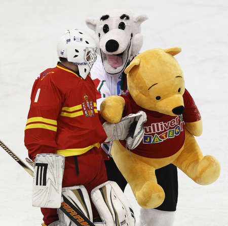 BUDAPEST - APRIL 22: Hungarian mascot figure (R) and Spanish Ander Alcaine after