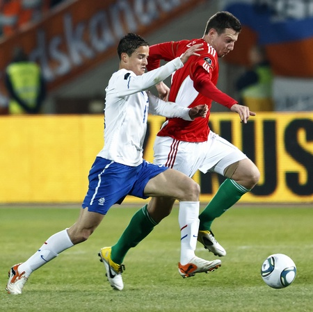 BUDAPEST - MARCH 25: Dutch Ibrahim Afellay (L) and Hungarian Akos Elek (R) during Hungary vs. Netherlands (0:4) UEFA Euro 2012 qualifying game at Puskas Ferenc Stadium on March 25, 2011 in Budapest, Hungary. Editorial