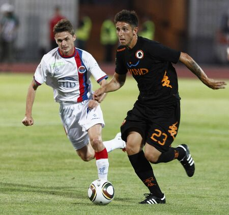 vasas: BUDAPEST - AUGUST 3: Bakos (L) of Vasas and Greco (R) of Roma during Vasas vs. AS Roma (0:1) friendly game at Puskas Stadium on August 3, 2011 in Budapest, Hungary