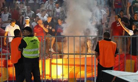vasas: BUDAPEST - AUGUST 3: Hooligans of Vasas are lighting fire during Vasas vs. AS Roma (0:1) friendly game at Puskas Stadium on August 3, 2011 in Budapest, Hungary.