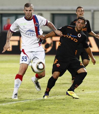 vasas: BUDAPEST - AUGUST 3: Suto (L) of Vasas and Caprari (R) of Roma during Vasas vs. AS Roma (0:1) friendly game at Puskas Stadium on August 3, 2011 in Budapest, Hungary. Editorial