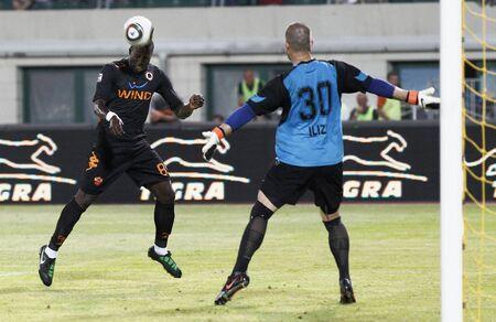 vasas: BUDAPEST - AUGUST 3: Ilizi (R) of Vasas and Okaka (L) of Roma during Vasas vs. AS Roma (0:1) friendly game at Puskas Stadium on August 3, 2011 in Budapest, Hungary