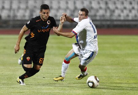 vasas: BUDAPEST - AUGUST 3: Arsic (R) of Vasas and Rosi (L) of Roma during Vasas vs. AS Roma (0:1) friendly game at Puskas Stadium on August 3, 2011 in Budapest, Hungary.