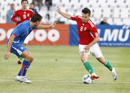 puskas: BUDAPEST - AUGUST 10: Hungarian Rudolf (R) and Icelander Jonsson during Hungary vs. Iceland (4:0) friendly game at Puskas Stadium on August 10, 2011 in Budapest, Hungary.
