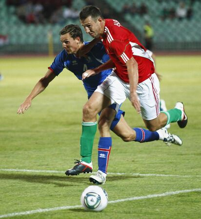 puskas: BUDAPEST - AUGUST 10: Hungarian Elek (R) and Icelander Jonsson during Hungary vs. Iceland (4:0) friendly game at Puskas Stadium on August 10, 2011 in Budapest, Hungary. Editorial