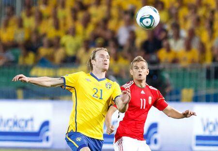 september 2: BUDAPEST - SEPTEMBER 2: Hungarian Vladimir Koman (R) and Swedish Christian Wilhelmsson during Hungary vs. Sweden (2:1) UEFA Euro 2012 qualifying game at Puskas Stadium on September 2, 2011 in Budapest, Hungary.