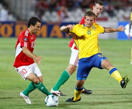 BUDAPEST - SEPTEMBER 2: Hungarian Tamas Hajnal (L) and Swedish Anders Svensson (8) during Hungary vs. Sweden (2:1) UEFA Euro 2012 qualifying game at Puskas Stadium on September 2, 2011 in Budapest, Hungary.