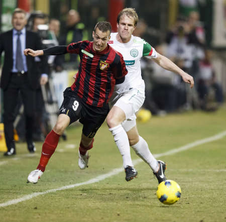 BUDAPEST - March 18: Klein of FTC (R) and Delczeg of Honved during FTC vs. Budapest-Honved Hungarian OTP BANK League football game at Albert Stadium on March 18, 2012 in Budapest, Hungary.