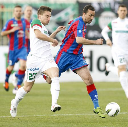 vasas: BUDAPEST - March 31: Kulcsar of FTC (L) and Dajic of Vasas during FTC vs. Vasas Hungarian OTP BANK League football game at Albert Stadium on March 31, 2012 in Budapest, Hungary. Editorial