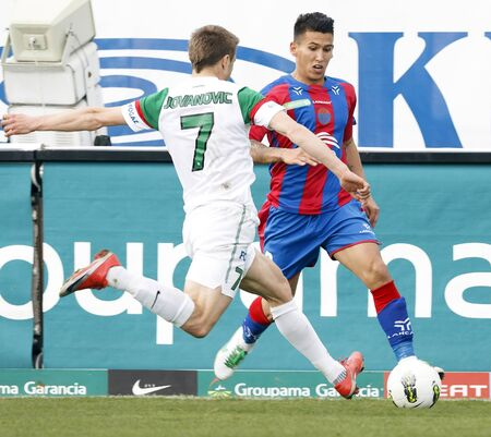 vasas: BUDAPEST - March 31: Jovanovic of FTC (L) and Daniel Kovacs of Vasas during FTC vs. Vasas Hungarian OTP BANK League football game at Albert Stadium on March 31, 2012 in Budapest, Hungary.