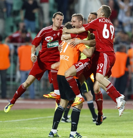BUDAPEST - May 1: The team-mates of DVSC are celebrating their goalkeeper (Verpecz) after his decisive save at the penalty shootout during MTK vs. DVSC Hungarian Cup Final football game at Puskas Stadium on May 1, 2012 in Budapest, Hungary