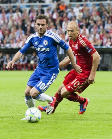 chelsea: MUNICH, May 19 - Mata of Chelsea (L) and Robben of Bayern during FC Bayern Munich vs. Chelsea FC UEFA Champions League Final game at Allianz Arena on May 19, 2012 in Munich, Germany.