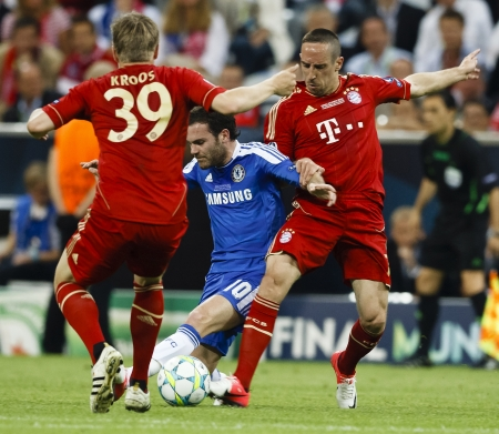 MUNICH, May 19 - Mata of Chelsea (M), Kroos (L) and Ribery (R) of Bayern during FC Bayern Munich vs. Chelsea FC UEFA Champions League Final game at Allianz Arena on May 19, 2012 in Munich, Germany.
