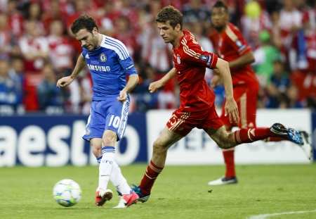 MUNICH, May 19 - Mata of Chelsea (L) and Muller of Bayern during FC Bayern Munich vs. Chelsea FC UEFA Champions League Final game at Allianz Arena on May 19, 2012 in Munich, Germany.