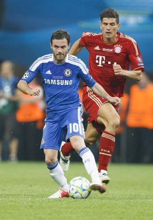 MUNICH, May 19 - Mata of Chelsea (L) and Gomez of Bayern during FC Bayern Munich vs. Chelsea FC UEFA Champions League Final game at Allianz Arena on May 19, 2012 in Munich, Germany.