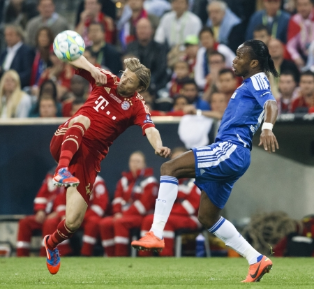 MUNICH, May 19 - Drogba of Chelsea (R) and of Bayern during FC Bayern Munich vs. Chelsea FC UEFA Champions League Final game at Allianz Arena on May 19, 2012 in Munich, Germany.