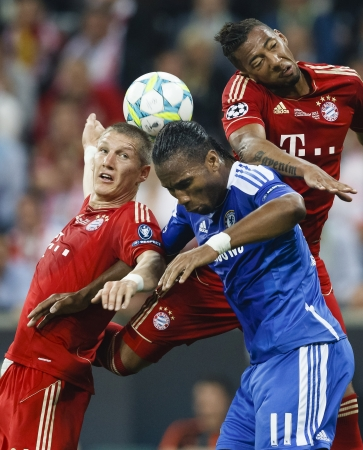 MUNICH, May 19 - Drogba of Chelsea (M) between Schweinsteiger (L) and Boateng (R) of Bayern during FC Bayern Munich vs. Chelsea FC UEFA Champions League Final game at Allianz Arena on May 19, 2012 in Munich, Germany.