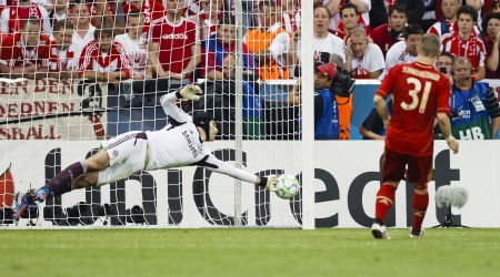 MUNICH, May 19 - Cech of Chelsea (L) saves the penalty shoot of Bayerns Schweinsteiger during FC Bayern Munich vs. Chelsea FC UEFA Champions League Final game at Allianz Arena on May 19, 2012 in Munich, Germany.