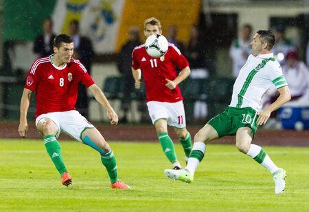 puskas: BUDAPEST, June 4 - Hungarian Pinter (L) and Irish Keane (R) during Hungary vs. Ireland friendly football game at Ferenc Puskas Stadium on June 4, 2012 in Budapest, Hungary.