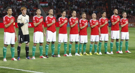 BUDAPEST - August 15: Hungarian team members listening to Hungarian Anthem before Hungary vs. Israel friendly football game at Puskas Stadium on August 15, 2012 in Budapest, Hungary. Stock Photo - 14817769