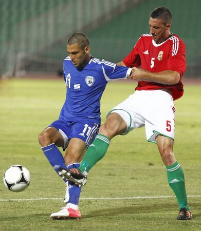 puskas: BUDAPEST - August 15: Hungarian Meszaros (R) and Israeli Shechter during Hungary vs. Israel friendly football game at Puskas Stadium on August 15, 2012 in Budapest, Hungary.