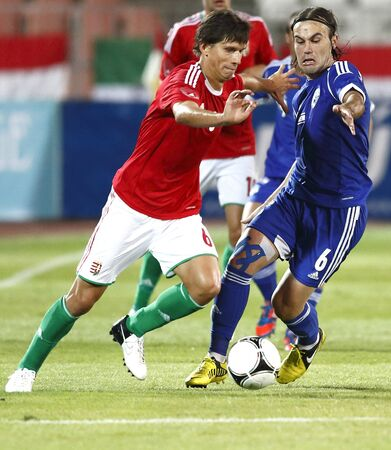 BUDAPEST - August 15: Hungarian Laczko (L) and Israeli Natcho during Hungary vs. Israel friendly football game at Puskas Stadium on August 15, 2012 in Budapest, Hungary. Stock Photo - 14817761
