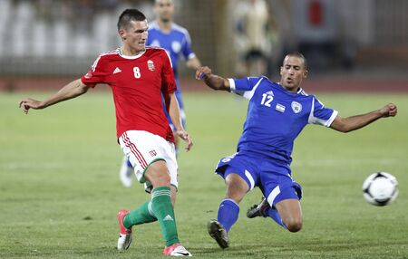 puskas: BUDAPEST - August 15: Hungarian Pinter (L) and Israeli Yadin during Hungary vs. Israel friendly football game at Puskas Stadium on August 15, 2012 in Budapest, Hungary.