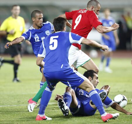 BUDAPEST - August 15: Hungarian Szalai (9), Israeli Yadin (12) and Mori (13) during Hungary vs. Israel friendly football game at Puskas Stadium on August 15, 2012 in Budapest, Hungary. Stock Photo - 14817767
