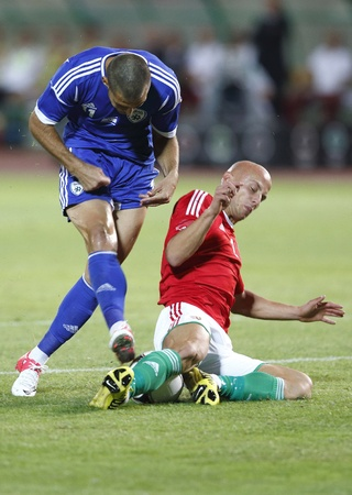 puskas: BUDAPEST - August 15: Hungarian Varga (R) and Israeli Shechter during Hungary vs. Israel friendly football game at Puskas Stadium on August 15, 2012 in Budapest, Hungary.