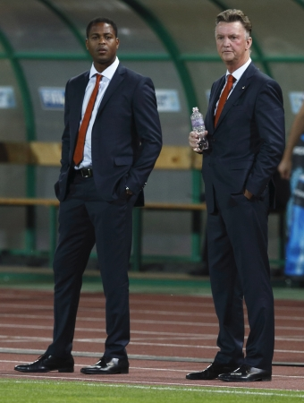 BUDAPEST - September 11: Dutch team management Louis van Gaal (R) and Patrick Kluivert during Hungary vs. Netherlands FIFA World Cup qualifier football game at Puskas Stadium on September 11, 2012 in Budapest, Hungary.