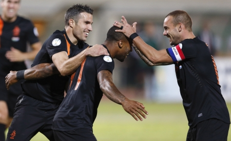 BUDAPEST - September 11: Dutch Robin van Persie (L) and Wesley Sneijder(R) with Jeremain Lens during Hungary vs. Netherlands FIFA World Cup qualifier football game at Puskas Stadium on September 11, 2012 in Budapest, Hungary.