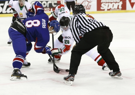 BUDAPEST - APRIL 14: Face off between Hungarian Istvan Bartalis (R) and British Matthew Myers during Great Britain vs. Hungary IIHF World Championship ice hockey match at Budapest Sportarena on April 14, 2013 in Budapest, Hungary.
