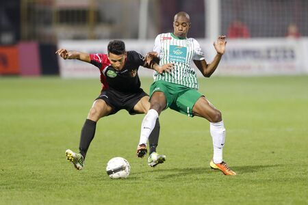 martinez: BUDAPEST - APRIL 16: Duel between Leandro Martinez of Honved (L) and Somalia of FTC during Honved vs. Ferencvaros (FTC) OTP Bank League football match at Bozsik Stadium on April 16, 2013 in Budapest, Hungary.  Editorial
