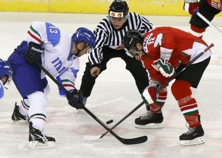 BUDAPEST - APRIL 19: Face-off between Hungarian Ladislav Sikorcin (R) and Italian Nathan di Casmirro during Hungary vs. Italy IIHF World Championship ice hockey match at Budapest Sportarena on April 19, 2013 in Budapest, Hungary.
