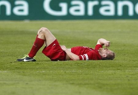 puskas: BUDAPEST - APRIL 28: Sandor Torghelle of Videoton is injured during FTC vs. Videoton OTP Bank League football match at Puskas Stadium on April 28, 2013 in Budapest, Hungary. Editorial