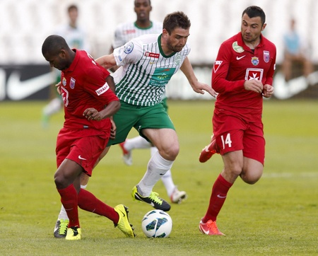 puskas: BUDAPEST - APRIL 28: Daniel Bode of FTC (M) tries to break out between Paulo Vinicius (L) and Nikola Mitrovic of Videoton during FTC vs. Videoton OTP Bank League football match at Puskas Stadium on April 28, 2013 in Budapest, Hungary. Editorial