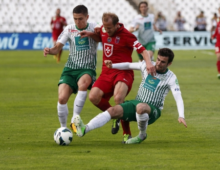 puskas: BUDAPEST - APRIL 28: Sandor Torghelle of Videoton tries to break out between Muhamed Besic (L) and Gabor Gyomber (R) of FTC during FTC vs. Videoton OTP Bank League football match at Puskas Stadium on April 28, 2013 in Budapest, Hungary.