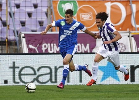 barnabas: BUDAPEST - APRIL 30: Alessandro Iandoli of Ujpest (R) chases Barnabas Bese of MTK during Ujpest vs. MTK OTP Bank League football match at Szusza Stadium on April 30, 2013 in Budapest, Hungary.